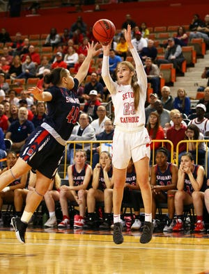 Seton Catholic guard Amanda Barcello (23) shoots a jumper over Sahuaro High guard Milaya Leon (40) in the 4A Girls basketball final at Veterans Memorial Coliseum on Feb. 29, 2020 in Phoenix, Ariz.