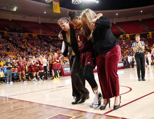 Arizona State guard Kiara Russell (4) is helped off the court after an injury against Stanford during the first half at Desert Financial Arena March 1, 2020.