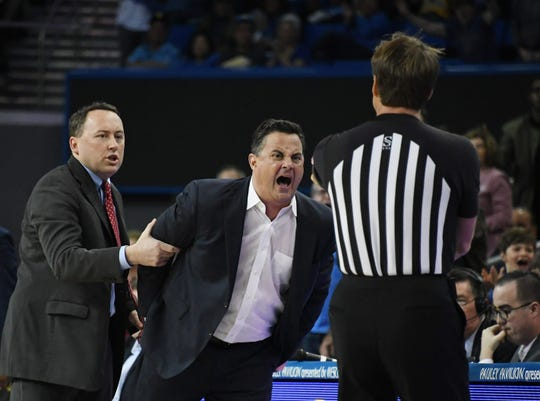 Arizona Wildcats head coach Sean Miller receives a technical foul against the UCLA Bruins in the first half at Pauley Pavilion.
