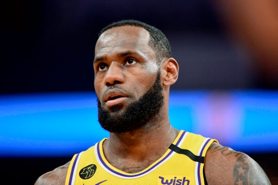 Los Angeles Lakers forward LeBron James (23) plays in the first half of an NBA basketball game against the Memphis Grizzlies Saturday, Feb. 29, 2020, in Memphis, Tenn. (AP Photo/Brandon Dill).
