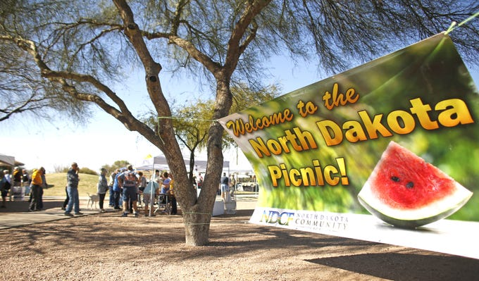 People arrive for the North Dakota Picnic, a celebration at Red Mountain Park in Mesa, Ariz. on March 1, 2020.