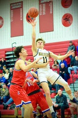 Port Huron Northern's James DeLong shoots over St. Clair's Ryan Zimmer during the Macomb Area Conference Blue/Gold boys basketball championship on Saturday, Feb. 29, 2020, at Chippewa Valley.
