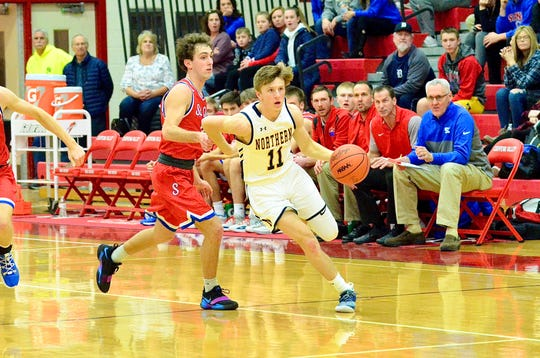 Port Huron Northern's James DeLong dribbles up the floor against St. Clair during the Macomb Area Conference Blue/Gold boys basketball championship on Saturday, Feb. 29, 2020, at Chippewa Valley.
