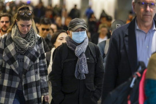 Some commuters at Union Station adorn breathing masks in Los Angeles, Calif. on Jan. 31, 2020. (Irfan Khan/Los Angeles Times/TNS)
