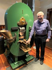 Bob Nylen stands with the 150-year-old mint.
