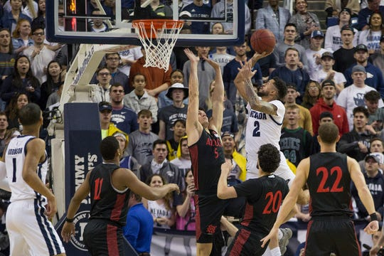 Nevada guard Jalen Harris (2) shoots over San Diego State forward Yanni Wetzell (5) during the first half of an NCAA college basketball game against San Diego State at Lawlor Events Center in Reno, Nev., Saturday, Feb. 29, 2020. (AP Photo/Tom R. Smedes)