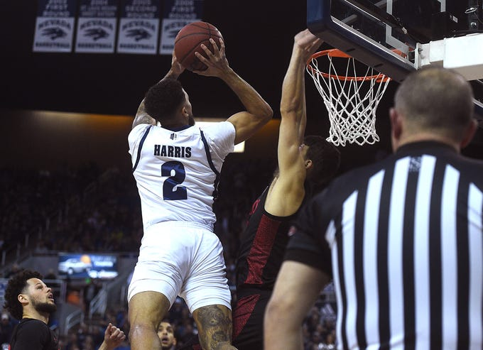 Nevada's Jalen Harris drives to the basket while taking on San Diego St. during their basketball game at Lawlor Events Center in Reno on Feb. 29, 2020.