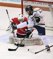 Thomas' Zack Wolfe tries to screen Canandaigua goalie Cade Chesler.
