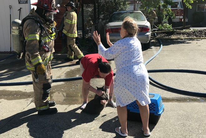 Firefighters were able to save a cat that was in a building that caught fire near downtown Redding on Sunday morning.