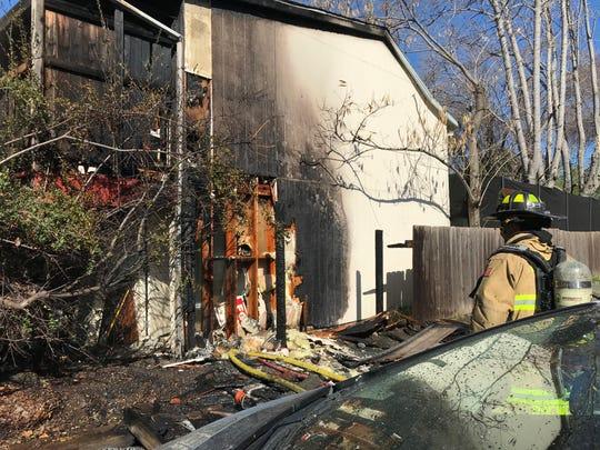 Fire damaged a building on Locust Street near downtown Redding on Sunday morning.