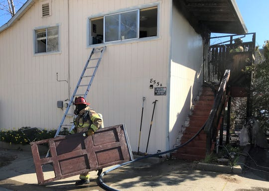 Firefighters put out a fire on Locust Street near downtown Redding on Sunday morning.