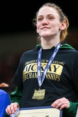 McKay's Tess Barnett receives first place in the 110-pound weight class during the OSAA girl's wrestling championship at the Memorial Coliseum in Portland on Saturday, Feb. 29, 2020.