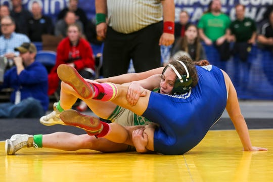 McKay's Tess Barnett takes down Grant Pass' Tiana Gilliland in the 110-pound weight class during the OSAA girl's wrestling championship at the Memorial Coliseum in Portland on Saturday, Feb. 29, 2020.