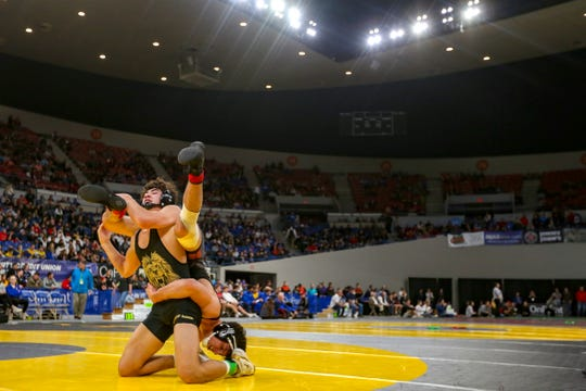 Sprague's Brook Byers and West Linn's Justin Rademacher compete in the 160-pound weight class during the OSAA Class 6A wrestling championship at the Memorial Coliseum in Portland on Saturday, Feb. 29, 2020.