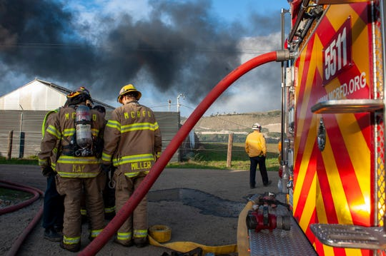 Monterey County firefighters worked together to put out half an acre of plastic burning on Natividad Road on Feb. 29, 2020.
