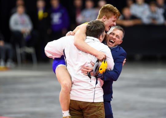 Canton's Braden Sehr leaps into the arms of his coaches after winning the class B-132 feature match of the high school state wrestling finals on Saturday, Feb. 29, at the Denny Sanford Premier Center in Sioux Falls.