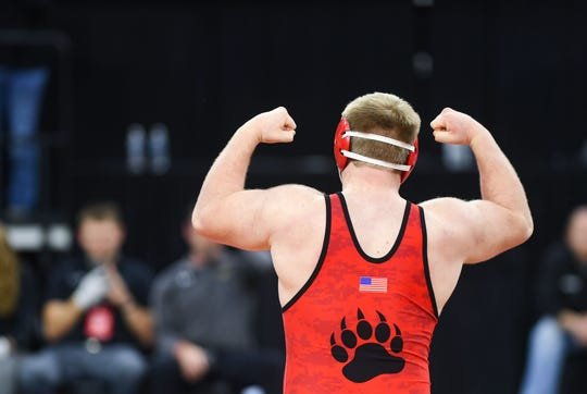 Chamberlain's Nash Hutmacher flexes after winning the class A-285 match of the high school state wrestling finals on Saturday, Feb. 29, at the Denny Sanford Premier Center in Sioux Falls.