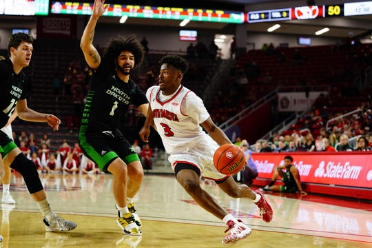 USD's Triston Simpson drives past Marlon Stewart of North Dakota during the Coyotes' 77-67 win on Saturday at the SCSC.