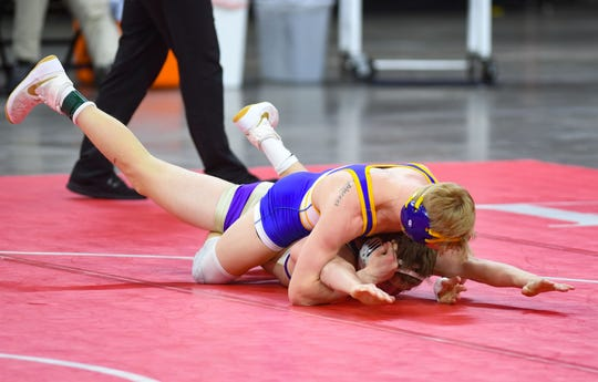 Canton's Kellyn March and Winner's Riley Orel wrestle during the class B-138 match of the high school state wrestling finals on Saturday, Feb. 29, at the Denny Sanford Premier Center in Sioux Falls.