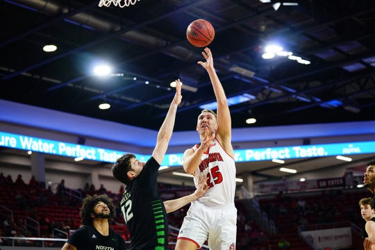 Tyler Hagedorn of USD goes up for a shot Saturday in his team's win over UND.