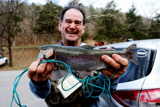 Michael Knight proudly displays a rainbow trout he caught during opening day of trout season March 1, 2020.