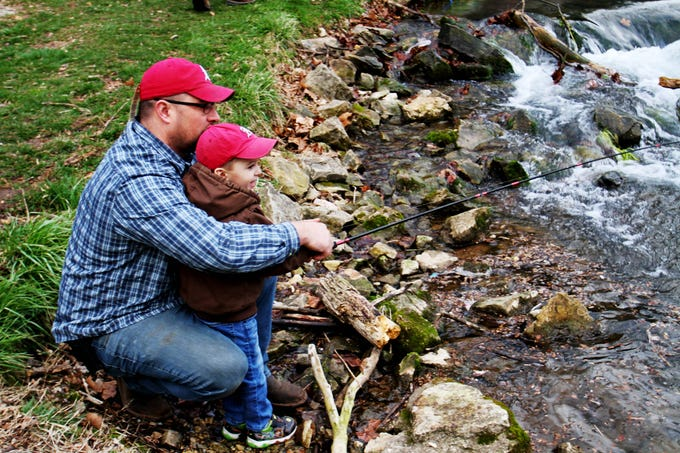 Eric Still helps his 4-year-old son, Jace, cast a fishing pole into Roaring River during opening day of trout season. March 1, 2020. Still said he used to come out to Roaring River State Park with his father to fish and now he gets to do the same with his son.