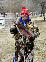 Jeff Greer, of Grove, Okla., holds one of the lunkers caught during opening day of trout season at Roaring River State Park. It was weighed at 9.1 pounds.