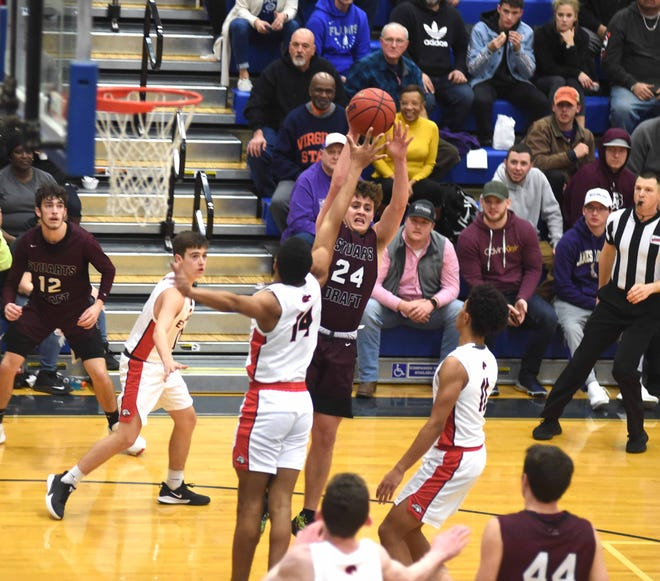Mark Rodgers shoots a jumper for the Cougars. Stuarts Draft lost to East Rockingham in the Region 2B championship at Spotswood High School.