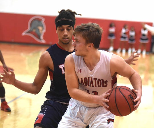 Riverheads' Elijah Dunlap works to find an open teammate Saturday afternoon. Riverheads beat Sussex Central to win the Region 1B boys basketball regional championship.