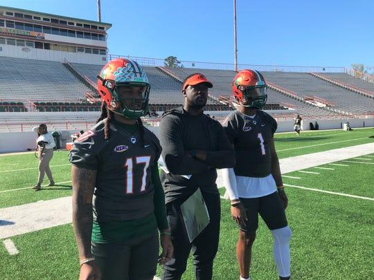 FAMU co-offensive coordinator/quarterbacks coach KJ Black views the action alongside RaSean McKay (left) and John Holcombe.