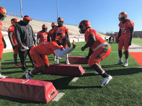 FAMU defensive linemen Abu Bangura (left) and Jolan Gilley work on their technique during the first day of spring practice on Saturday, Feb. 29, 2020.