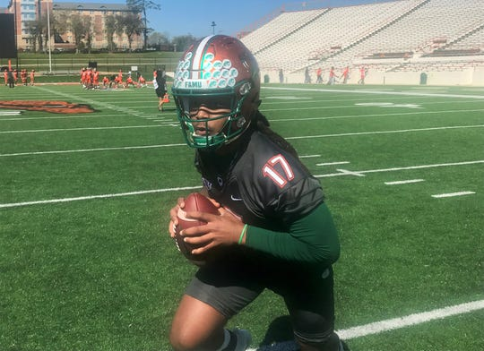 FAMU quarterback RaSean McKay rolls out for a pass during the first day of spring practice on Saturday, Feb. 29, 2020.