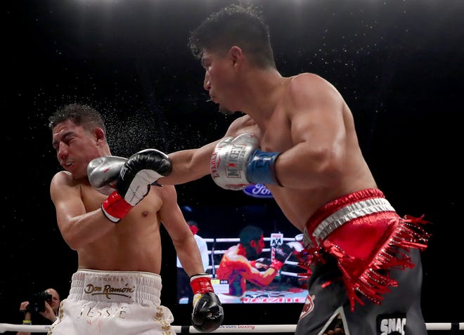 Pacifica High graduate Mikey Garcia lands a punch to the face of Jessie Vargas in the 12th round of their bout in Frisco, Texas, on Saturday. Garcia won by unanimous decision.