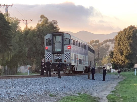 Authorities search the scene after a woman was killed by an Amtrak train in Ventura late Saturday afternoon.