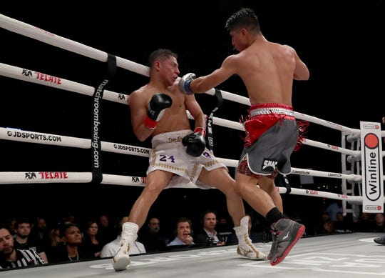 Pacifica High graduate Mikey Garcia has Jessie Vargas on the ropes during their bout in Frisco, Texas, on Saturday. Garcia won by unanimous decision.