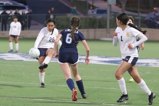 Santa Clara midfielder Yami Ordaz (26) plays the ball ahead for forward Bella Garcia against host Linfield Christian in the CIF-Southern Section Division 7 championship game on Saturday night in Temecula. Both players scored goals, but Linfield Christian won, 3-2, in overtime.