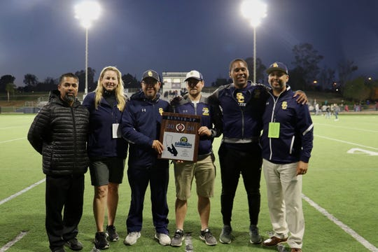 Santa Clara administrators and coaches poses with the CIF-Southern Section Division 7 runner-up plaque on Saturday night in Temecula. The girls soccer team fell to host Linfield Christian in the final, 3-2, in overtime.
