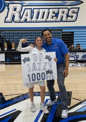 Moorpark College sophomore Jazzy Carrasco celebrates her 1,000th career point with head coach Kenny Plummer after Saturday's playoff win over Riverside.