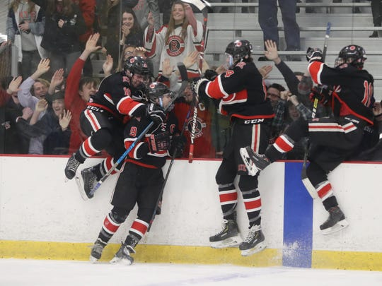 Rye celebrates a goal during their 5-1 win of John Jay Cross River in the Section 1 Division 2 hockey championship at the Brewster Ice Arena March 1, 2020.