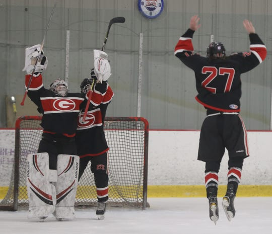 Rye celebrates after defeating John Jay 5-1 in the Section 1 Division 2 hockey championship at the Brewster Ice Arena March 1, 2020.