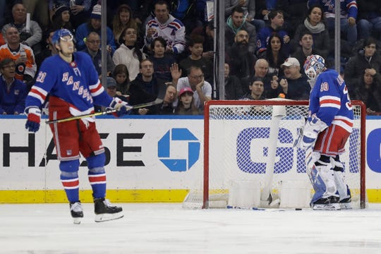 New York Rangers goaltender Henrik Lundqvist, right, reacts after being scored in by the Philadelphia Flyers during the second period of the NHL hockey game, Sunday, March 1, 2020, in New York. (AP Photo/Seth Wenig)