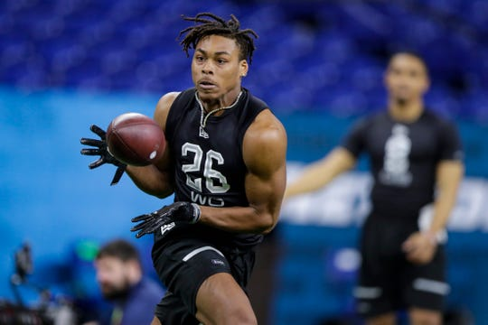 LSU wide receiver Justin Jefferson runs a drill at the NFL football scouting combine in Indianapolis, Thursday, Feb. 27, 2020. (AP Photo/Michael Conroy)