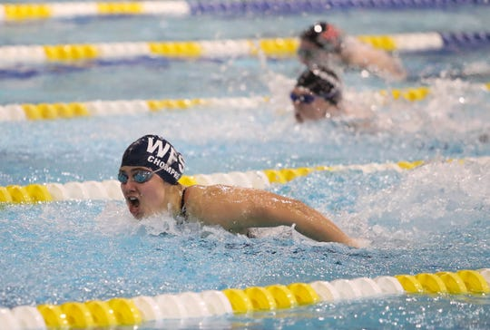 Wilmington Friends' Ashley Chompre churns to victory in the 100-yard butterfly during the DIAA Girls Swimming and Diving Championships on Feb. 29 at Rawstrom Natatorium.