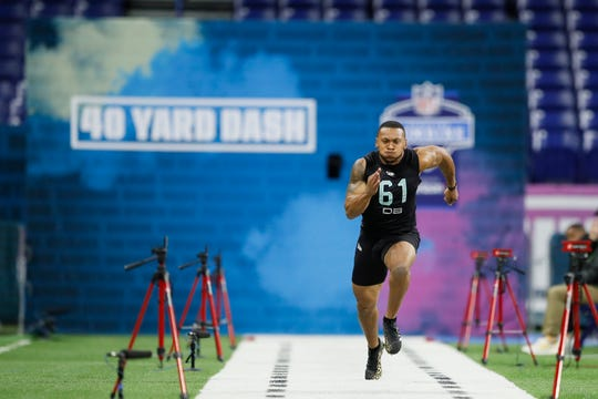 Minnesota defensive back Antoine Winfield Jr. runs the 40-yard dash at the NFL football scouting combine in Indianapolis, Sunday, March 1, 2020. (AP Photo/Charlie Neibergall)