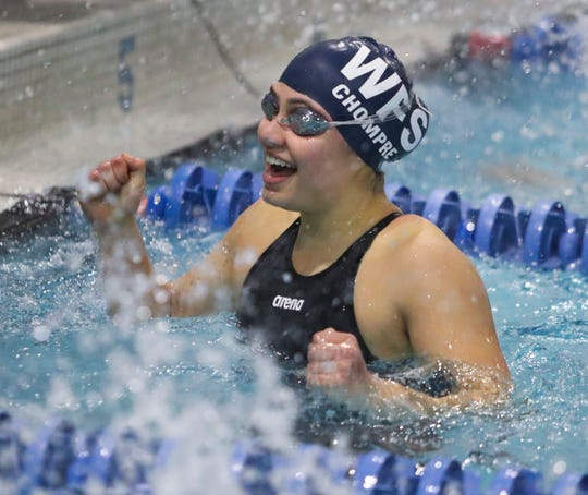 Wilmington Friends' Ashley Chompre celebrates after winning the 100-yard butterfly during the DIAA Girls Swimming and Diving Championships on Feb. 29 at Rawstrom Natatorium.