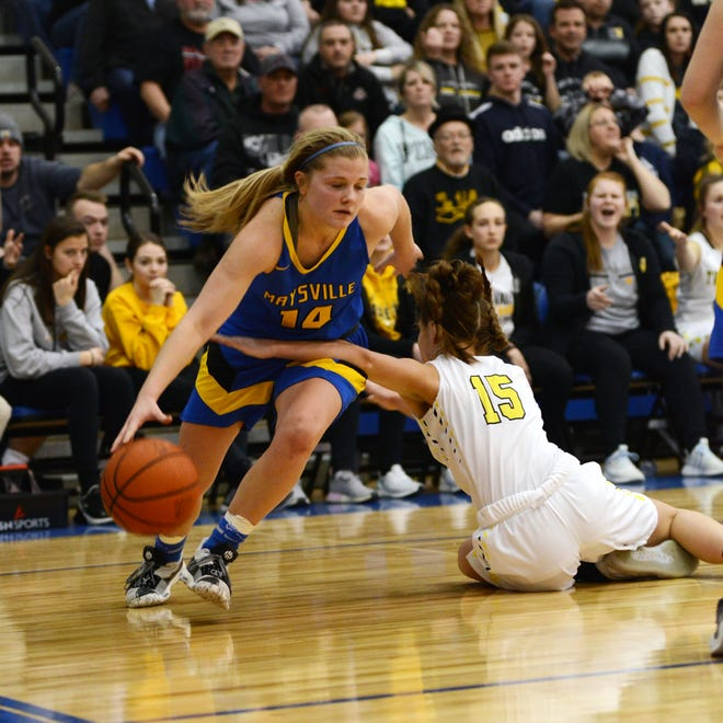 Bailee Smith, of Maysville, drives past Tri-Valley's Lauren King during a Division II district final on Saturday at West Muskingum's Gary Ankrum Gymnasium.