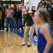 Tri-Valley coach Kurt Kaufman yells out instructions during the fourth quarter of a Division II district final against Maysville on Saturday at West Muskingum's Gary Ankrum Gymnasium.