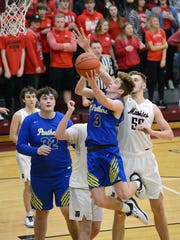 Kaiden Hartman flies in for a shot during the third quarter against John Glenn in a Division II sectional final on Saturday in New Concord. Hartman scored a game-high 20 points.