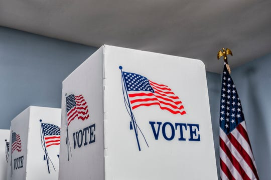 March 2020 file photo of voting booths.
