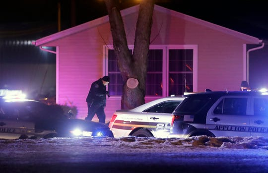 Appleton police and Outagamie County sheriff's deputies respond to an incident late Wednesday, Feb. 26, 2020, at North Kensington Drive, near East Newberry Street in Appleton, Wis.
